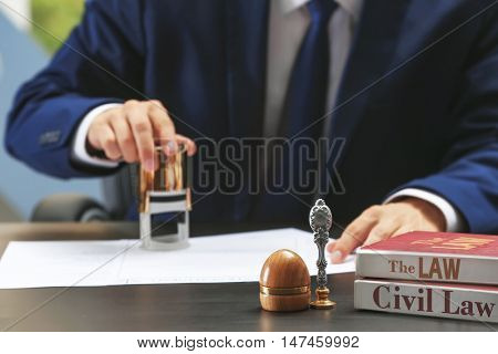 Notary public in office stamping document