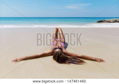 Young Pretty Slim Brunette Woman In Sunglasses Sunbathe On Beach