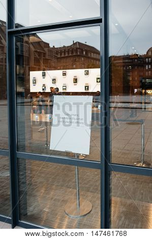 PARIS FRANCE - SEPTEMBER 16 2016: New Apple iPhone 7 Plus launch event - special schedules for the week of launch advertising on Apple Store door. New Apple iPhone tends to become one of the most popular smart phones in the world in 2016