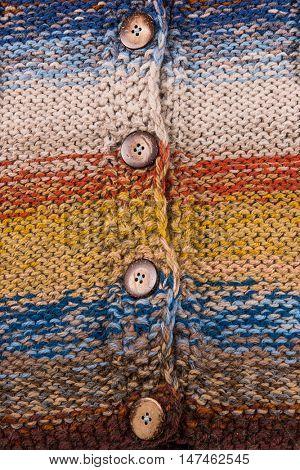 striped colorful wool texture handmade patten closeup macro blue ' yellow pink purple orange beige brown buttons