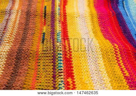 striped colorful wool texture handmade patten closeup macro blue red  yellow pink purple orange brown