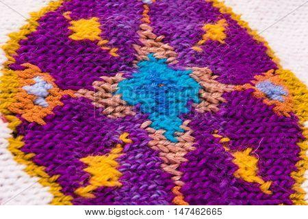 striped colorful wool texture handmade patten closeup macro blue  yellow  purple orange white ornament