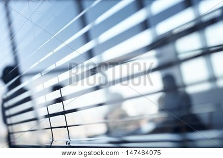 Close up of blinds in dark office