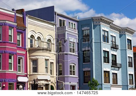 Adams Morgan neighborhood in US capital. Sunny spring day on the street of a vibrant city neighborhood.