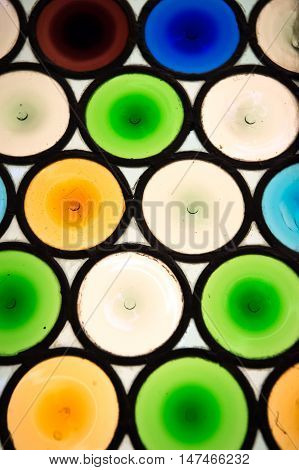 abstract pattern window background of colorful glass round shape as textured backdrop with nobody