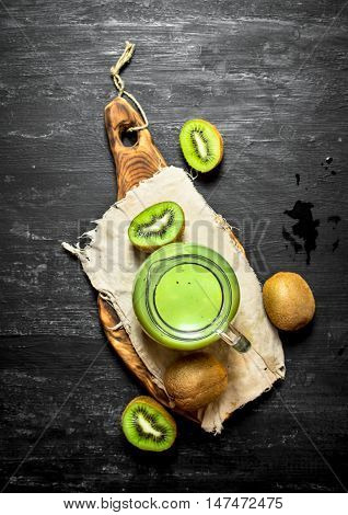 Fitness food. Fresh juice of kiwi in the pitcher.