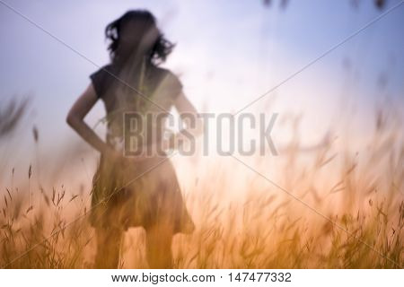 Blur photo of emotions moment of girl with flowers waiting for first summer.
