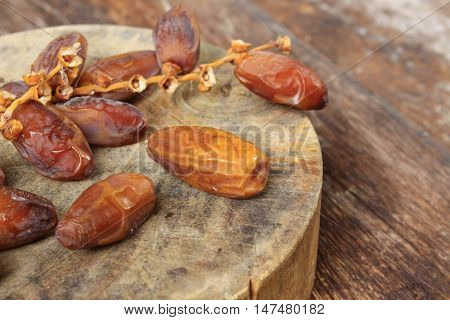 Dried date palm. fruit Delicious fresh organic date palm on the wooden floor :Close up select focus front date palm with shallow depth of field :