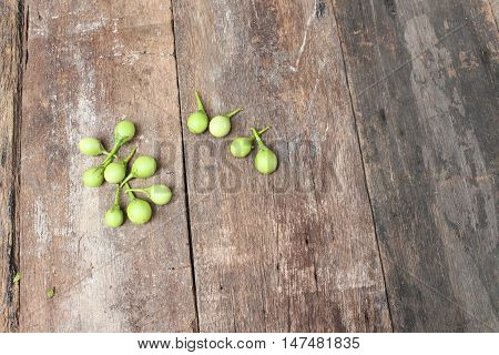 eggplant fresh organic green vegetable on wooden background.(Solanum melongena Solanum virginianum L.)