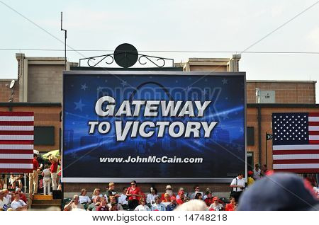 O'FALLON - AUGUST 31: A crowd gathers before Senator McCain and Saran Palin make their appearance at a rally in O'Fallon near St. Louis, MO on August 31, 2008