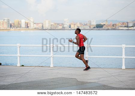 Young Man Running By The Sea