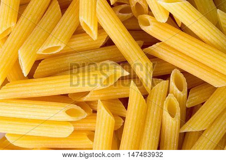 Macro of penne pasta noodles piled up