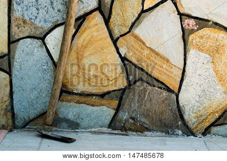 Pickaxe Leaned-to a Wall With Big Mosaic Stones