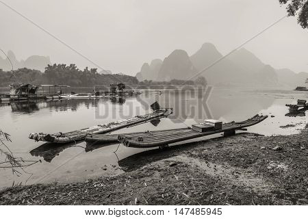 Traditional chinese bamboo rafts - black and white photography.