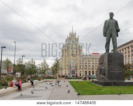 September 10 2016: People walk around the monument to poet Vladimir Mayakovsky in the city center near the Mayakovskaya metro station September 10 2016 Moscow Russia