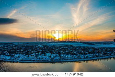 winter landscape sunset over the village horizon