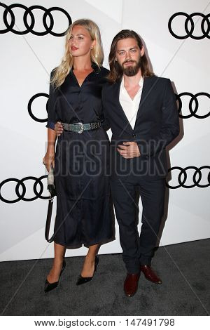 LOS ANGELES - SEP 15:  Jennifer Akerman, Tom Payne at the Audi Celebrates The 68th Emmys at the Catch on September 15, 2016 in West Hollywood, CA