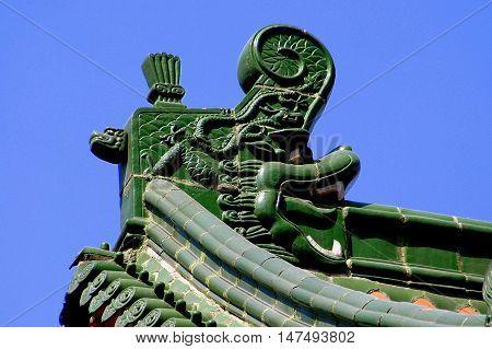 Xi'an China - September8 2006: Green ceramic tile dragon roof beam at c. 265 A. D. Da Xing San Temple