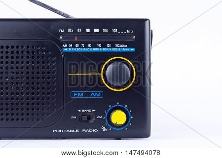 AM, FM portable radio transistor receiver of black vintage retro style   on white background  isolated  close up
