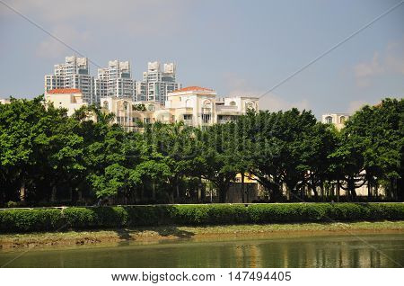 Apartment buildings alongside a river in the city of Guangzhou China in Guangdong province.
