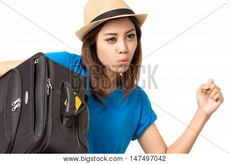 asian woman carrying a big black luggage