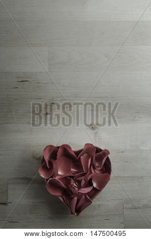 Aerial View Of Rose Petals In Heart Shaped Bowl On Wood