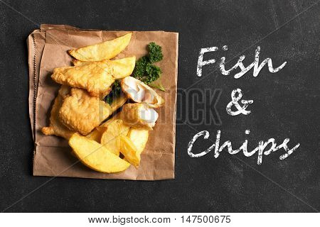 Traditional British fish and chips on the black chalkboard