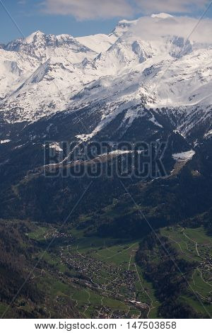 The green of the valley bottom in spring contrasting with the snowy peak of Grand Combin 3000 metres above.