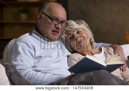 Elderly People Reading Book