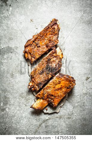Pork ribs grill. On a stone background.