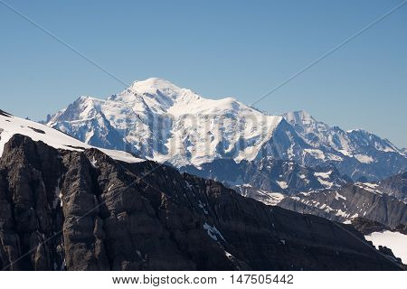 The massive summit dome of Mont Blanc towers above the surrounding alpine peaks.