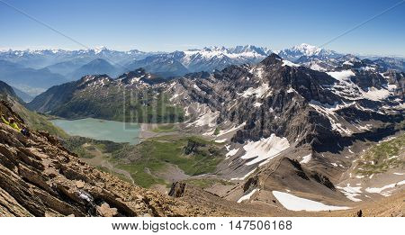 Panoramic shot from the summit of Haute Cime in the Swiss alps. Lac de Salanfe lies in the centre of the frame with the Chamonix valley and Mont blanc on the right and Verbier and the Matterhorn on the left.