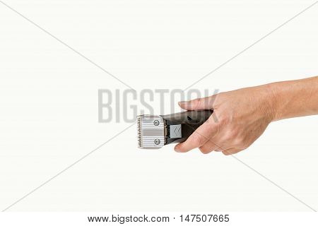 Woman hand is holding electric razor for grooming pets isolated on the white background