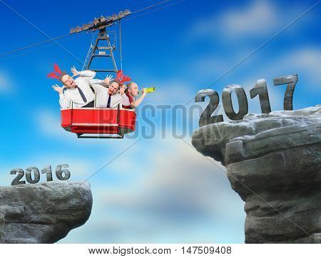 Crazy celebration of New Year 2017. A drunken businessmens in cable car going on peak. Greeting card for your business partners.