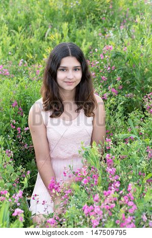 A Girl teenager on a beautiful meadow