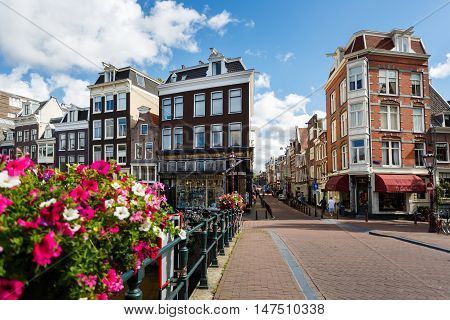 Amsterdam Netherlands - July 02 2016: The traditional Dutch houses on Prinsengracht street sunny day