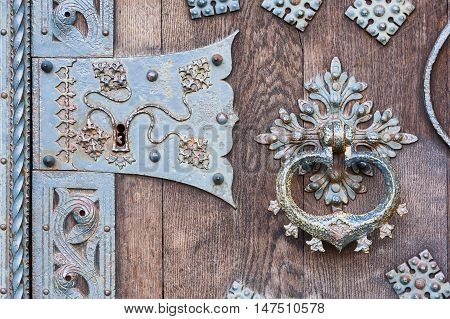 Close up of old gothic door with knocker.