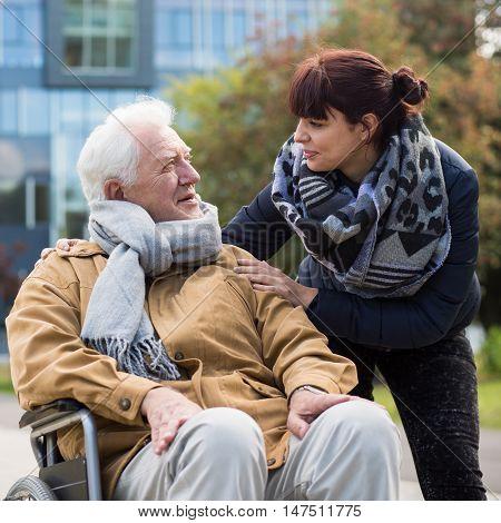Granddaughter And Disabled Grandpa