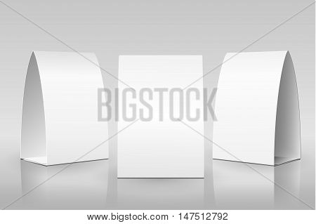 Blank Table Tent isolated on grey background. Paper vertical cards on white background with reflections. Front, left and right view. Vector illustration.