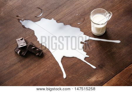 Chocolate and spilled milk on the table.Top view. Eco life concept.