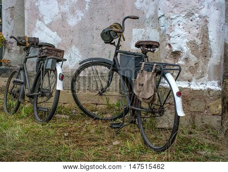 Gatchina, Russia - September 11, 2016: The historical reconstruction of World War II. Two bicycle since World War II. Bicycles Nazi soldiers. Baggage - boxes of ammunition, gas masks and kaolin bag.