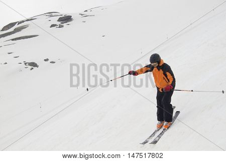 skier going down of a mountain skiing