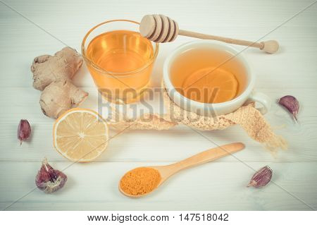Vintage Photo, Cup Of Tea With Lemon And Ingredients For Preparation Warming Beverage