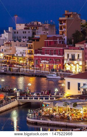 Agios Nikolaos, Greece - July 27, 2012: Tourists Eating In Restaurants Near Voulismeni Lake