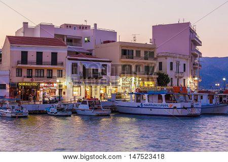 Agios Nikolaos, Greece - July 28, 2012: Tourists Walking In City Center