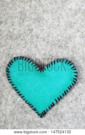 blue felt heart on a gray background