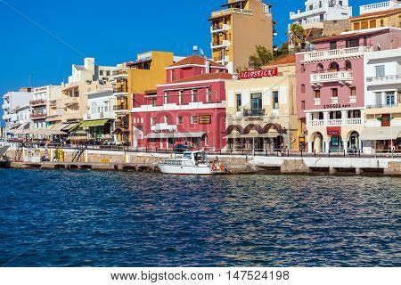 Agios Nikolaos, Greece - August 1, 2012: Tourists Walking In City Center Before Sunset