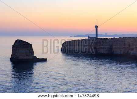 Sea Coast Sunset View With Lighthouse.