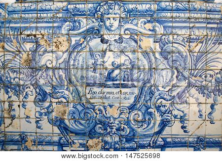COIMBRA PORTUGAL - JULY 31 2016: Azulejo tilework in Coimbra Portugal depicting