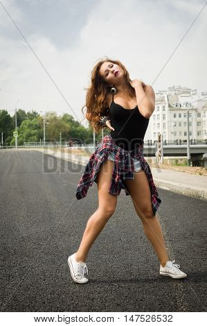 Young Girl Dancing Regeton On A City Street